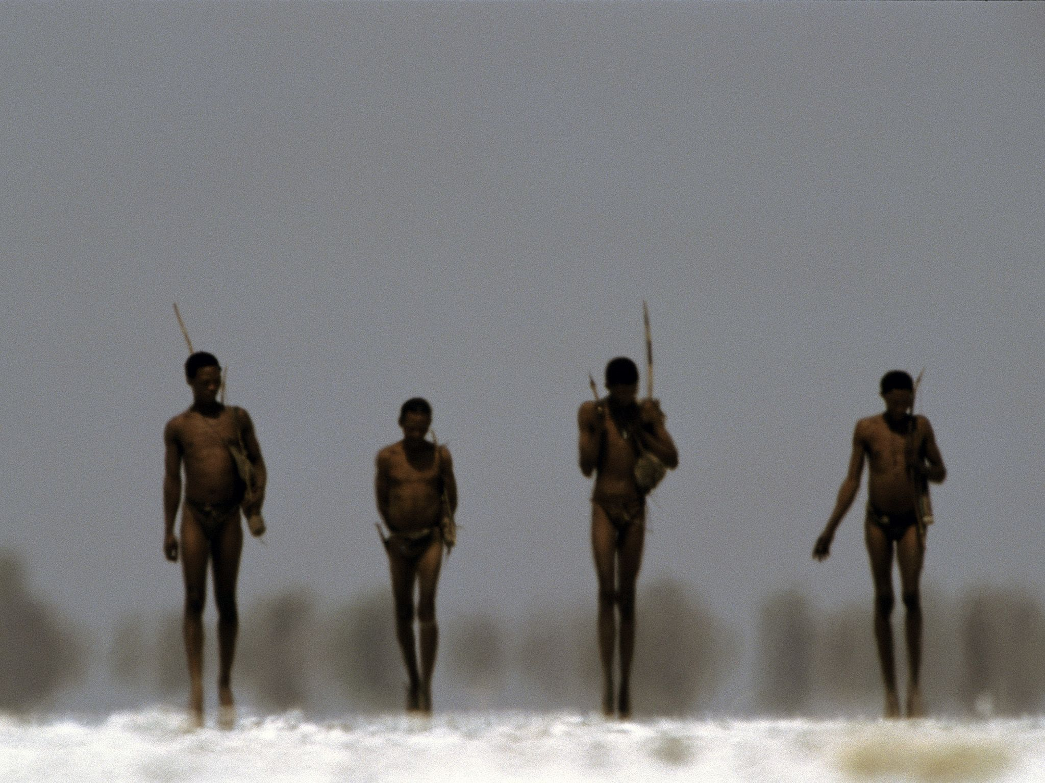 Bushmen armed with bows and arrows walk across a salt pan in Nyae Nyae Conservancy, Namibia.... [Photo of the day - March 2020]