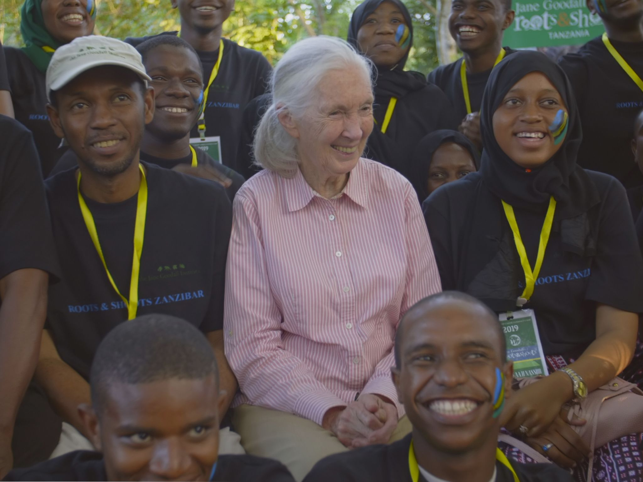 Dr. Jane Goodall posing with members of Roots & Shoots, a program of the Jane Goodall Institute.... [Photo of the day - April 2020]