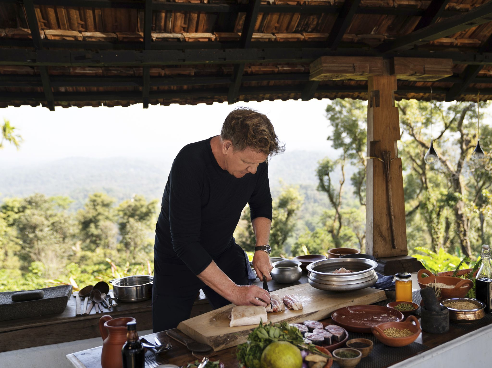 Gordon Ramsay cutting pork during the big cook. This image is from Gordon Ramsay: Uncharted. [Photo of the day - August 2020]
