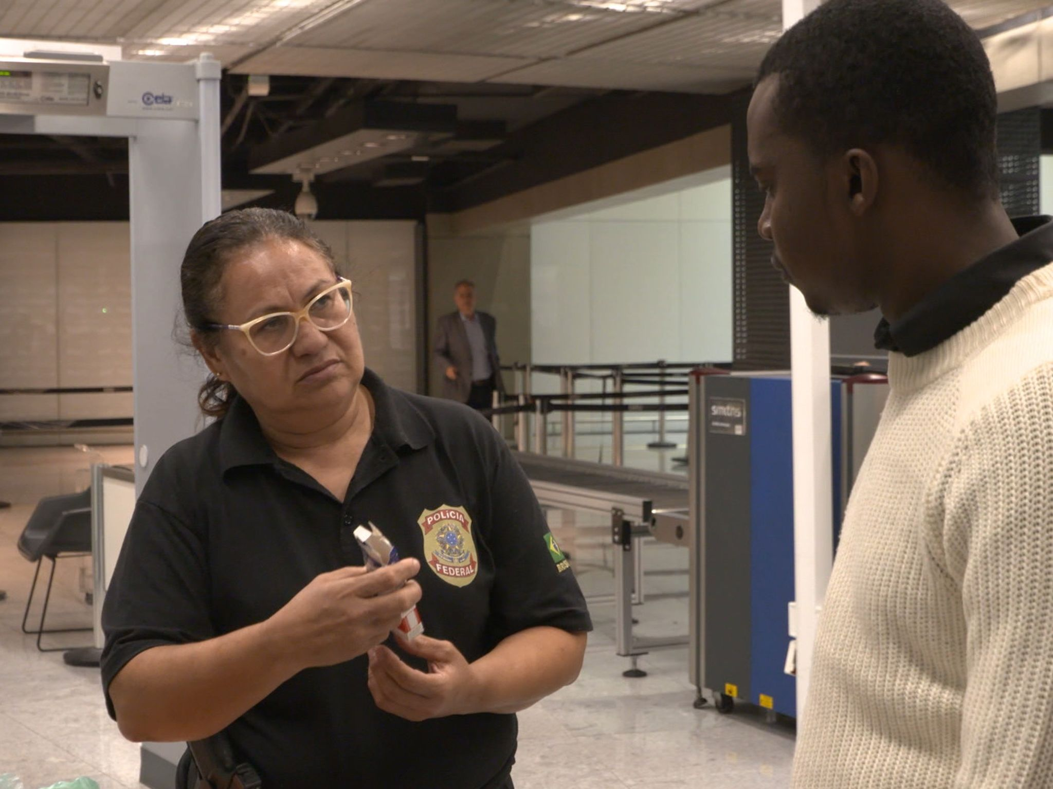 Police interrogate a passenger. This image is from Airport Security. [Photo of the day - October 2020]