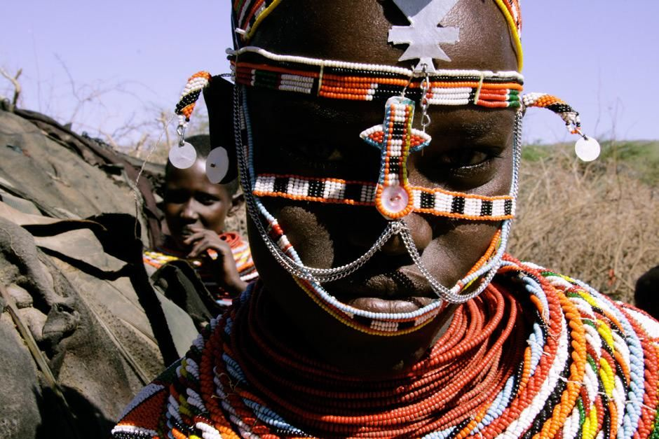 Kenya: A Samburu girl in traditional dress inside her village.  This image is from A World of... [Photo of the day - May 2012]