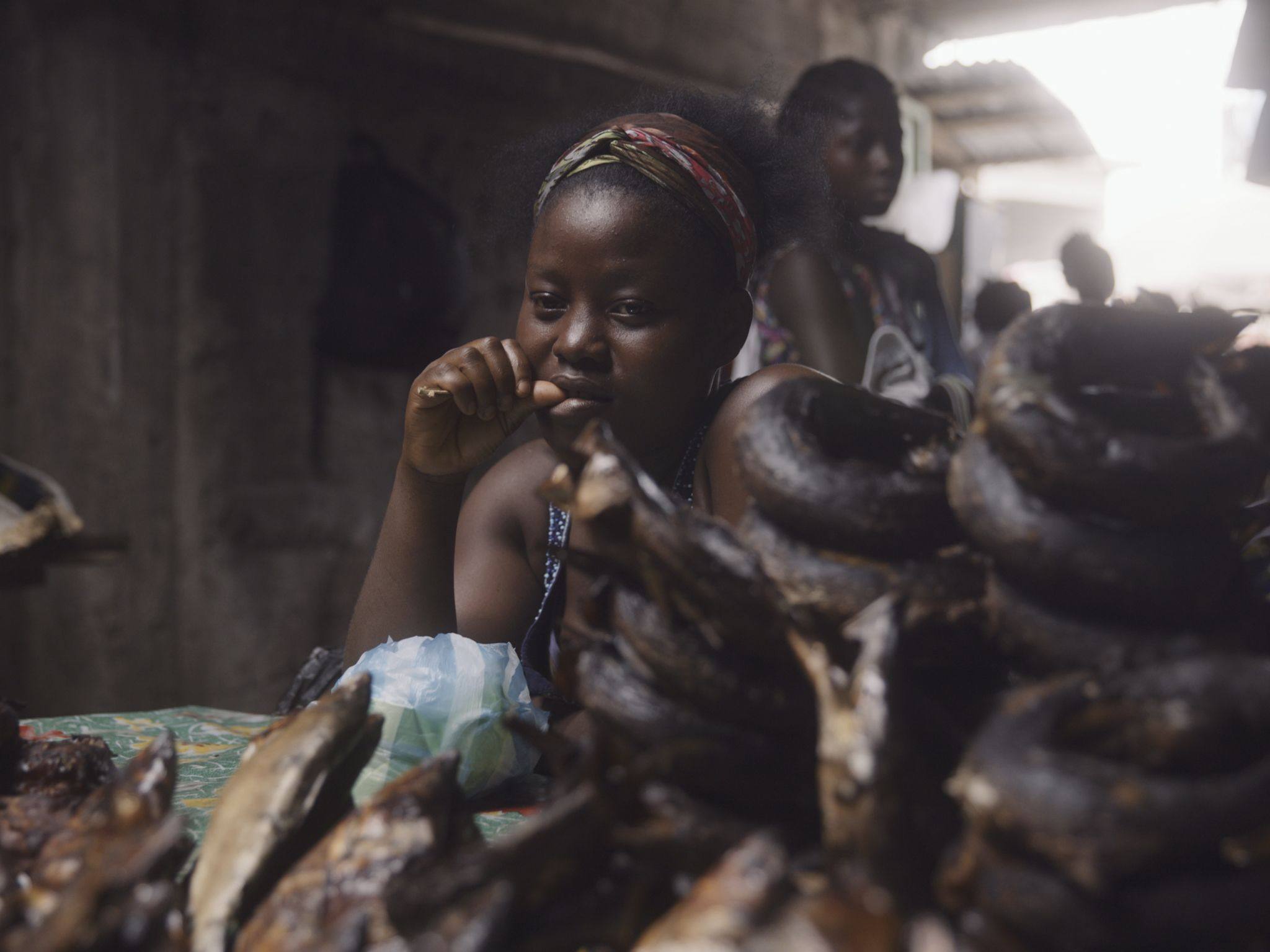A woman sells bushmeat at a market, which can create risk of viral transmission from animals to... [Photo of the day - November 2020]