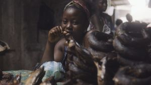 A woman sells bushmeat at a market,... [Photo of the day - 21 NOVEMBER 2020]