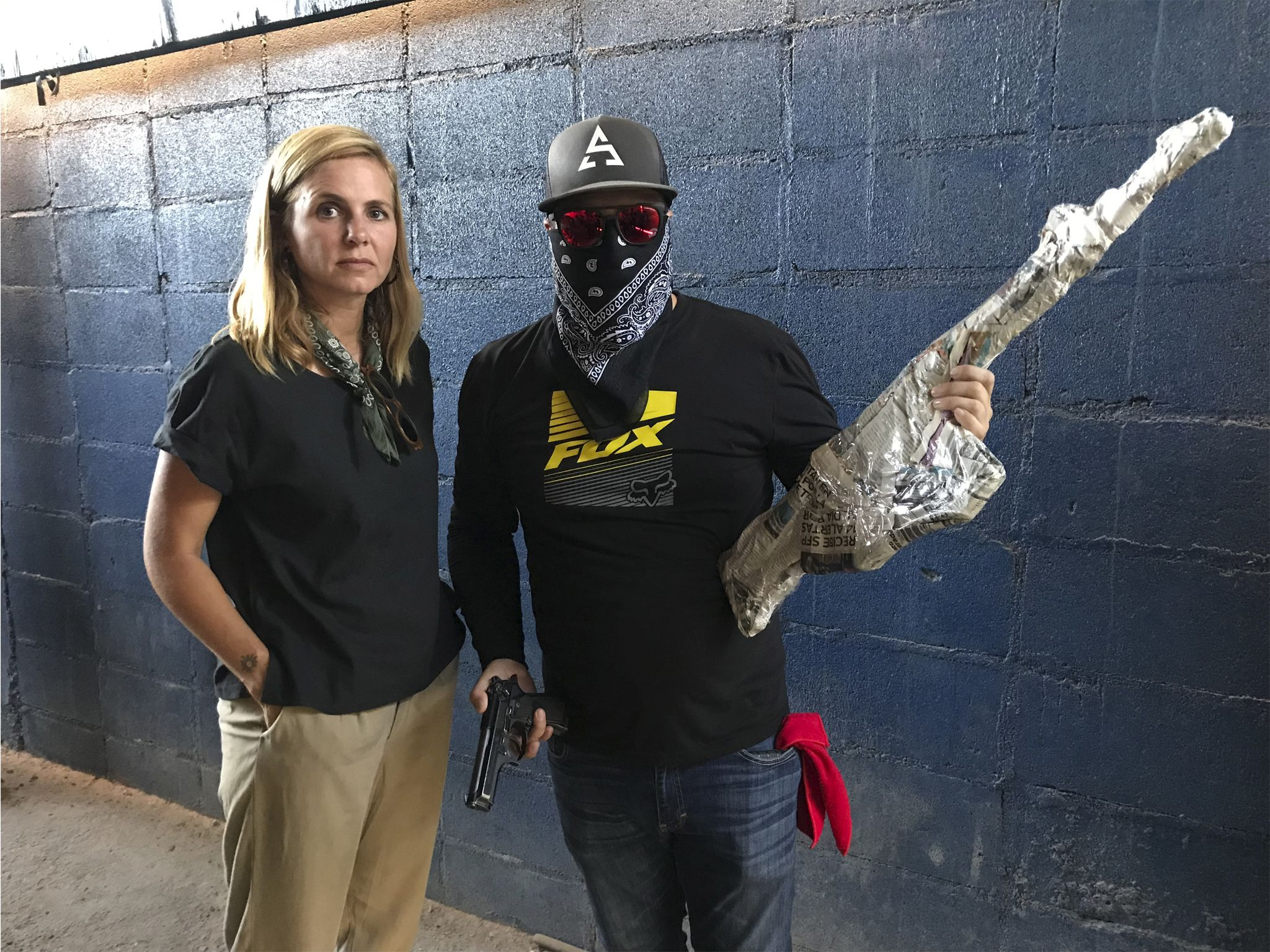 Mariana van Zeller (L) with a gun runner for the Sinaloa Cartel as he holds an automatic weapon... [Photo of the day - January 2021]