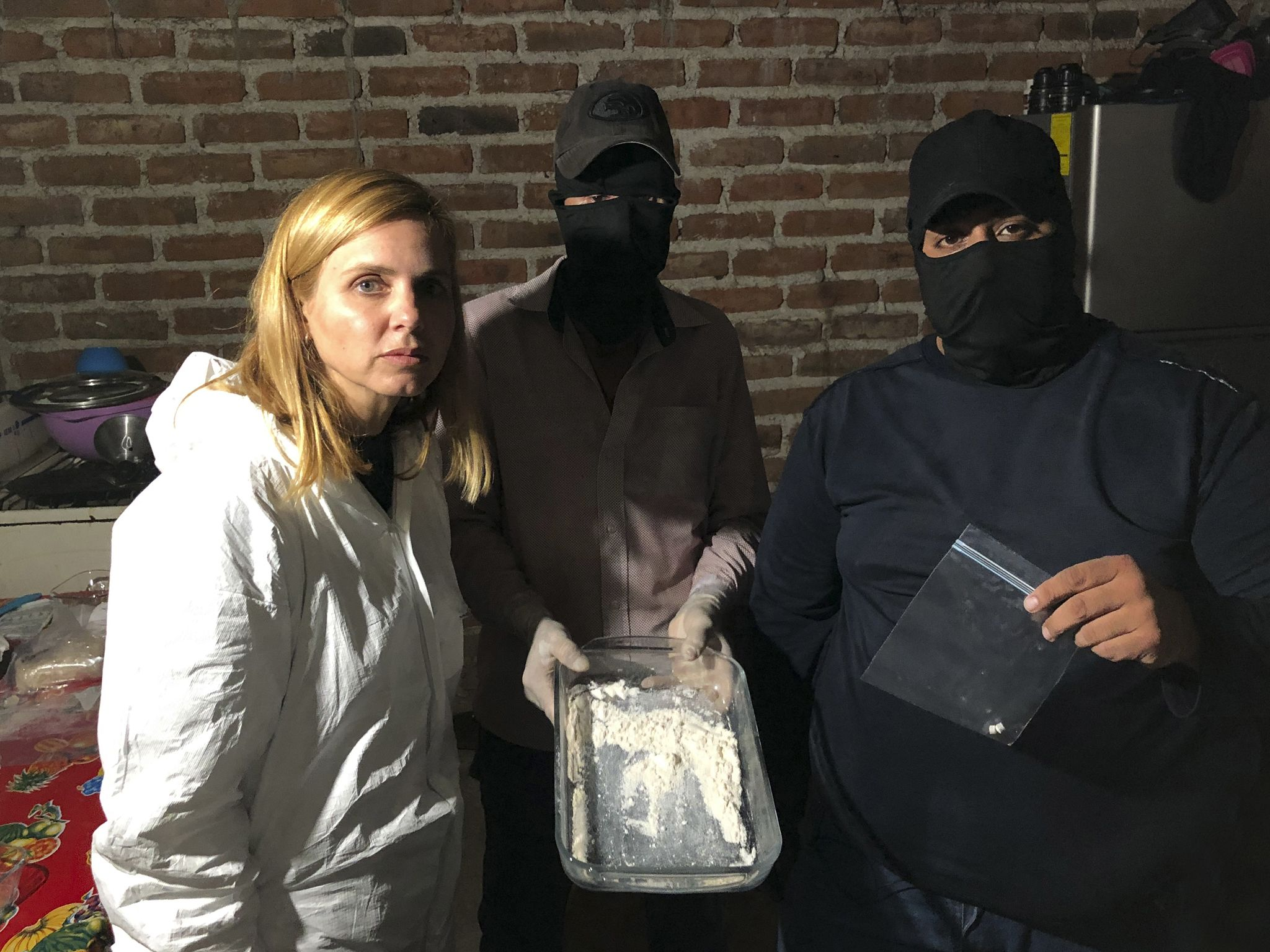Mariana van Zeller (L) with cartel chemists in a fentanyl lab. This image is from Trafficked... [Photo of the day - January 2021]