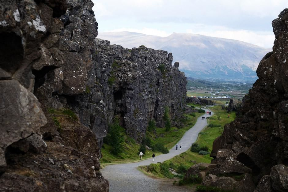 Thingvellir National Park, Iceland - Tourists walk through Iceland's Thingvellir rift valley,... [Photo of the day - May 2012]
