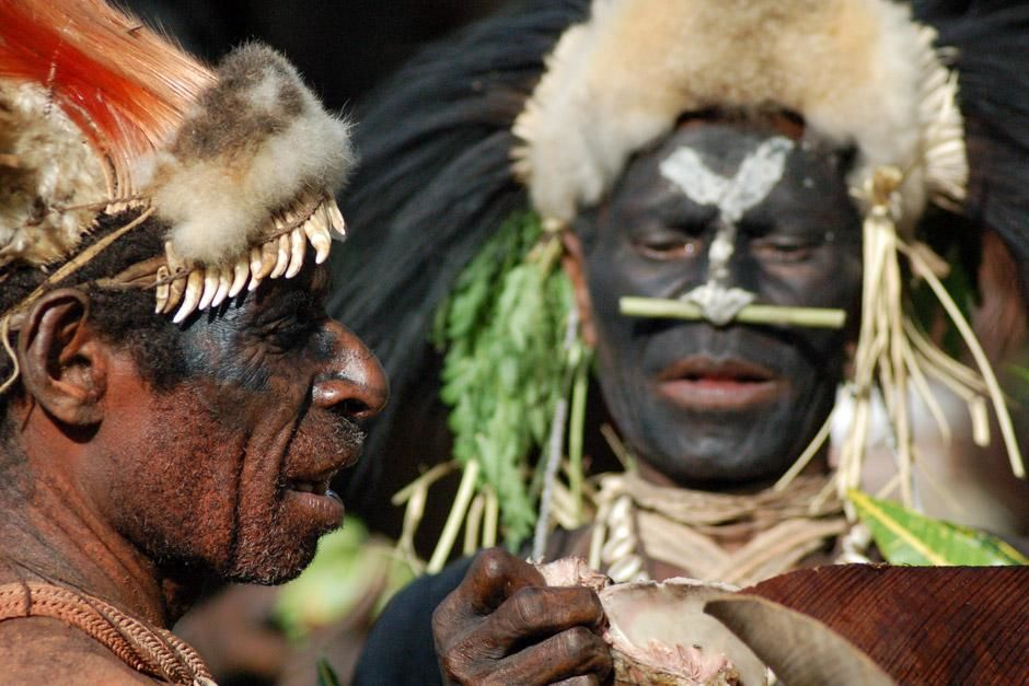 Papua New Guinea, Western Province: Two members of The Biami tribe in Negadai village prepare... [Photo of the day - May 2012]