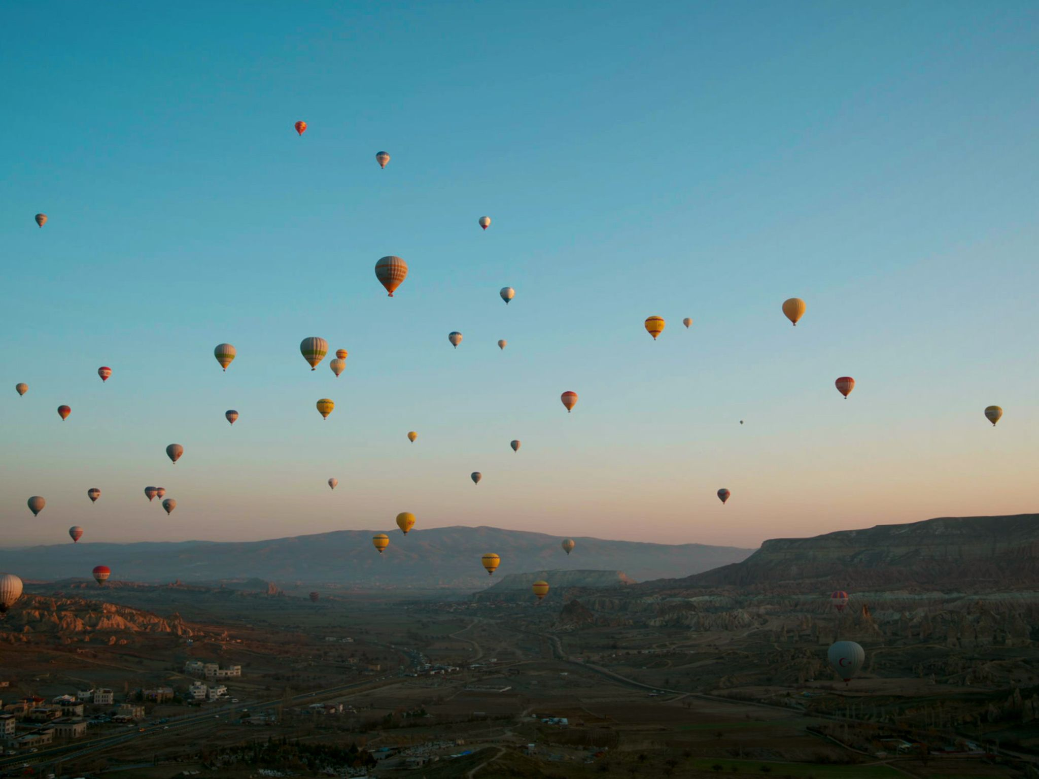 Multiple hot air balloons fly high above Cappadocia. This image is from Europe From Above. [Photo of the day - February 2020]