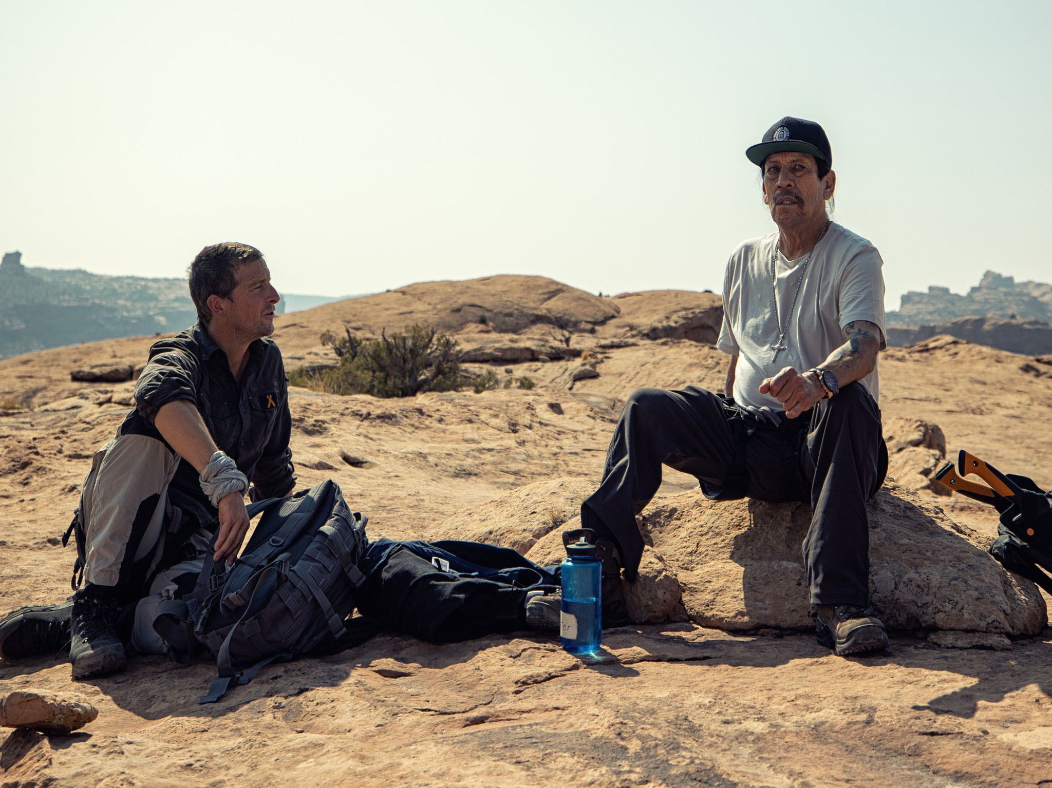 Bear Grylls and Danny Trejo stop to chat. This image is from Running Wild with Bear Grylls. [Photo of the day - April 2021]