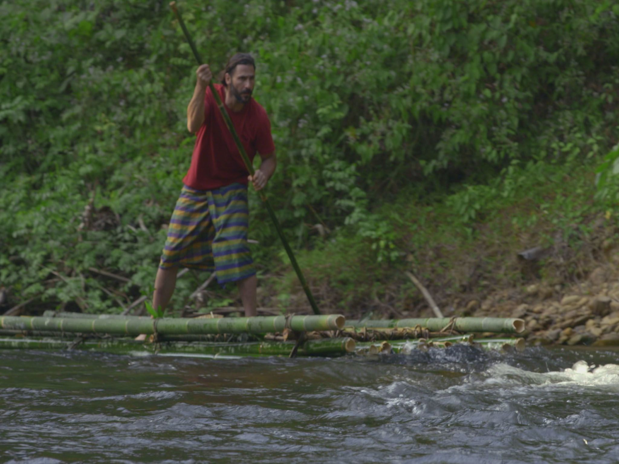 Hazen on a raft moving through river rapids. This image is from Primal Survivor. [Photo of the day - April 2021]
