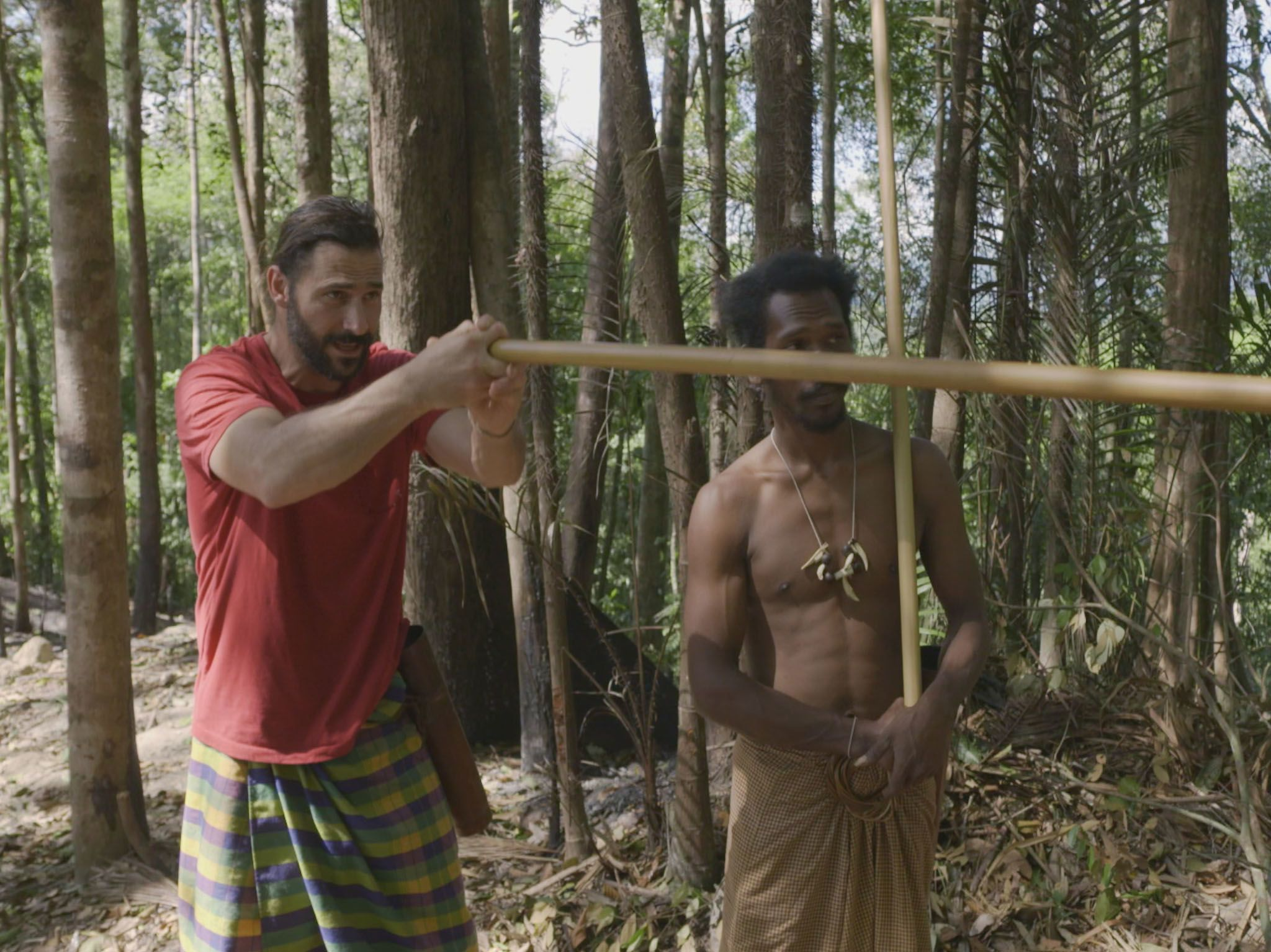 Hazen holding a dart blow gun practicing shooting targets. This image is from Primal Survivor. [Photo of the day - April 2021]