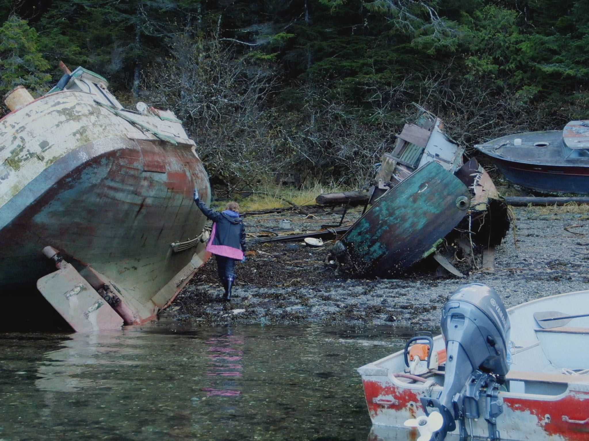 Mary Miller looks through the Boat Graveyard in search of parts to build an outhaul for her... [Photo of the day - May 2021]