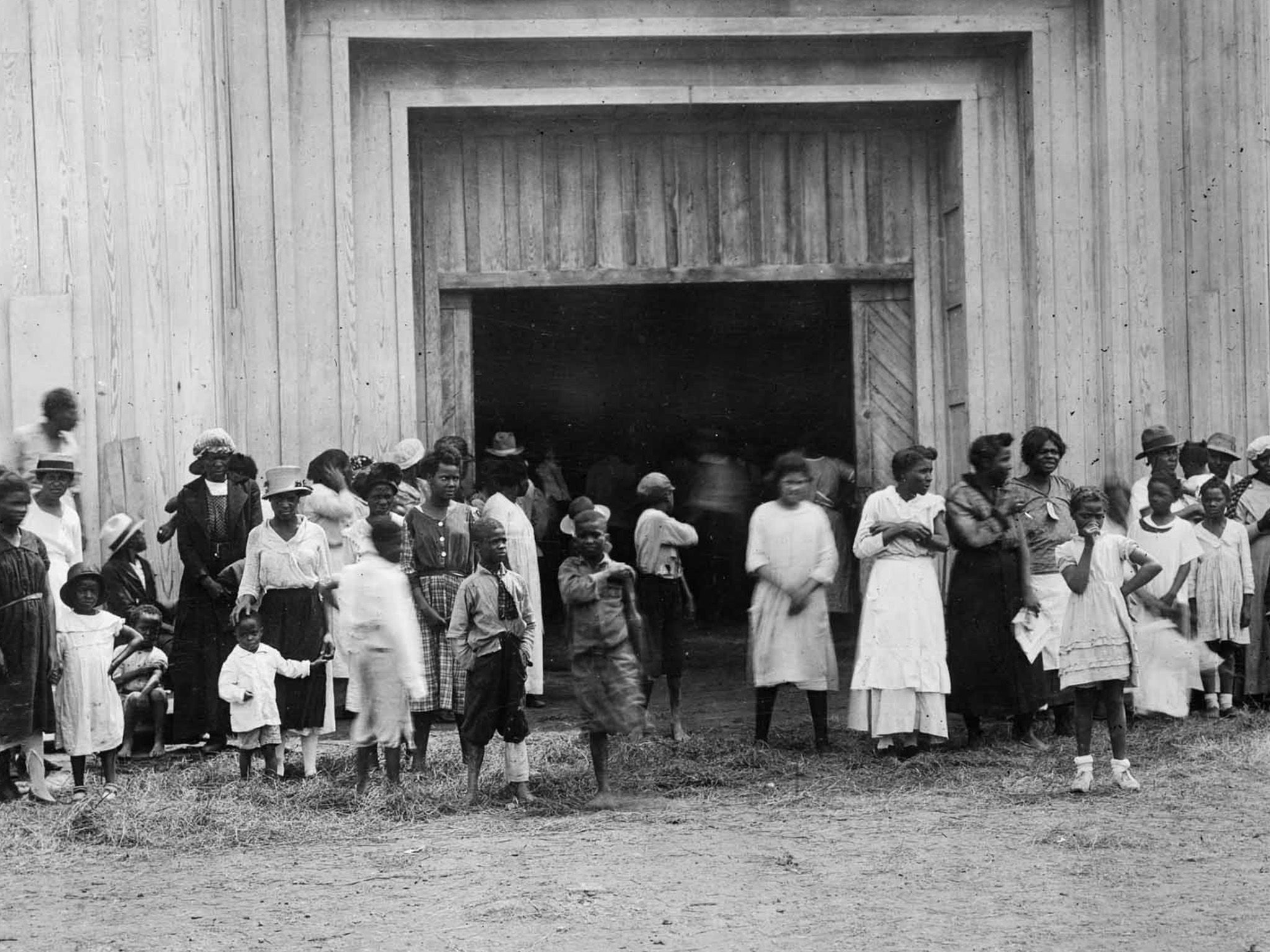 People gathered at the entrance to the refugee camp at the fairgrounds, after the Tulsa Race... [Photo of the day - July 2021]