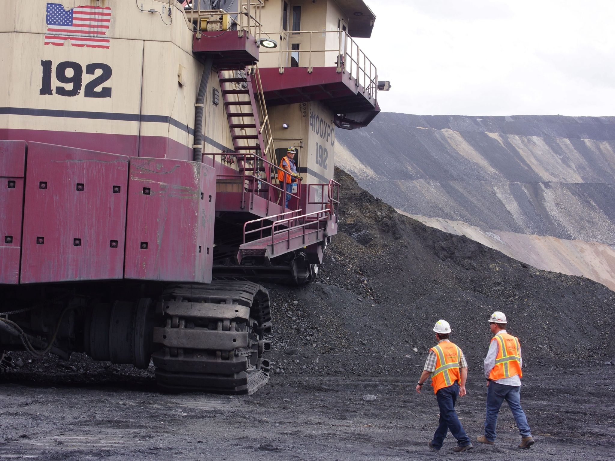 ALT LAKE CITY, UTAH- Two Barrick Gold employees are dwarfted by the huge digging machine at the... [Photo of the day - August 2021]