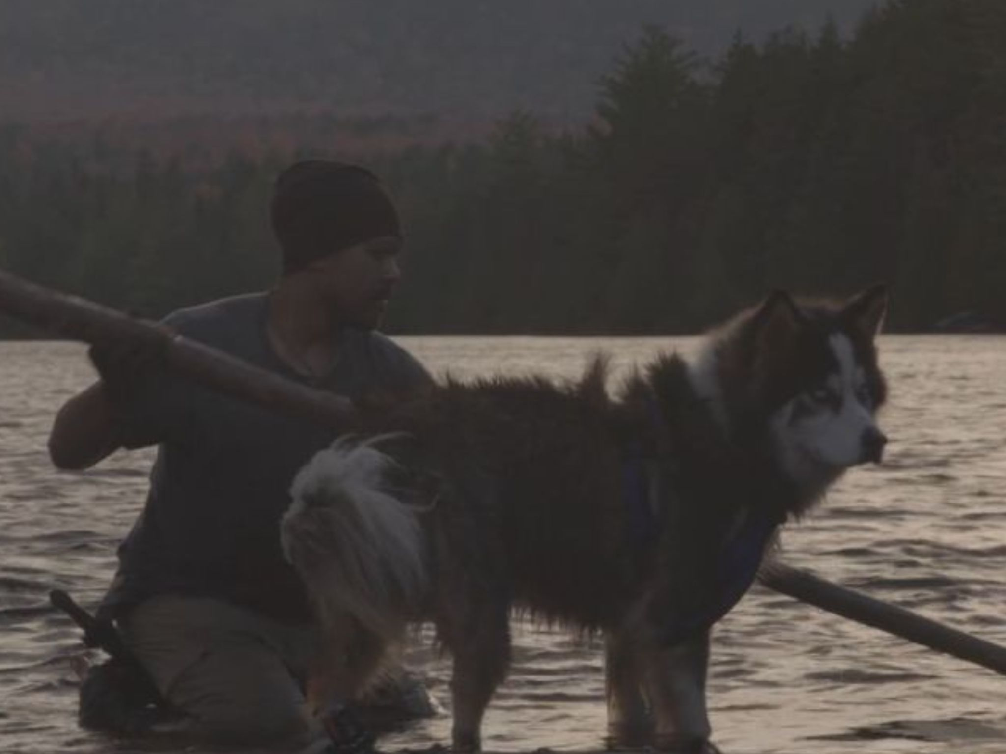 Keali'i Kaapana and his dog Hoku rafting back to shore.  This is from Called to the Wild. [Photo of the day - August 2021]