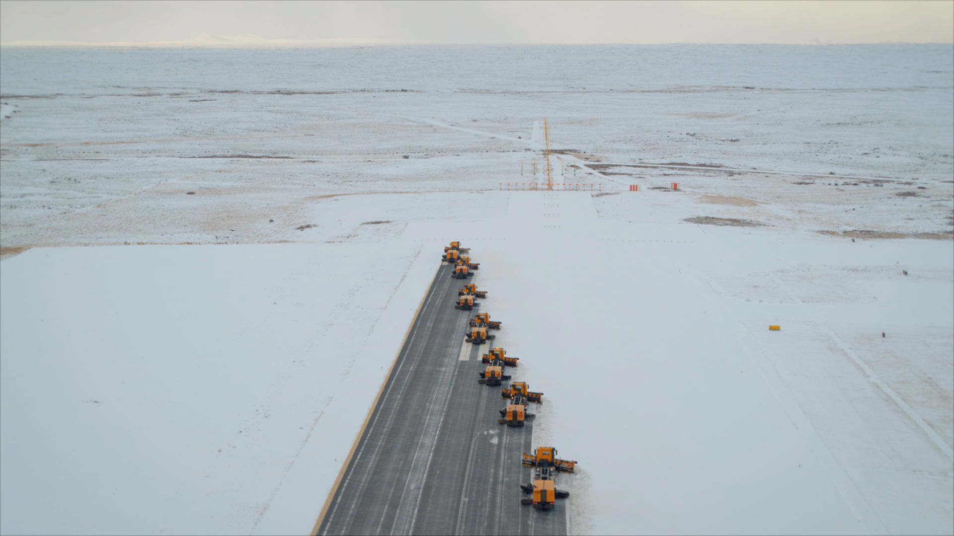 Snow plow machines clearing the runway at Keflavik airport. This is from Europe from above,... [Photo of the day - September 2021]