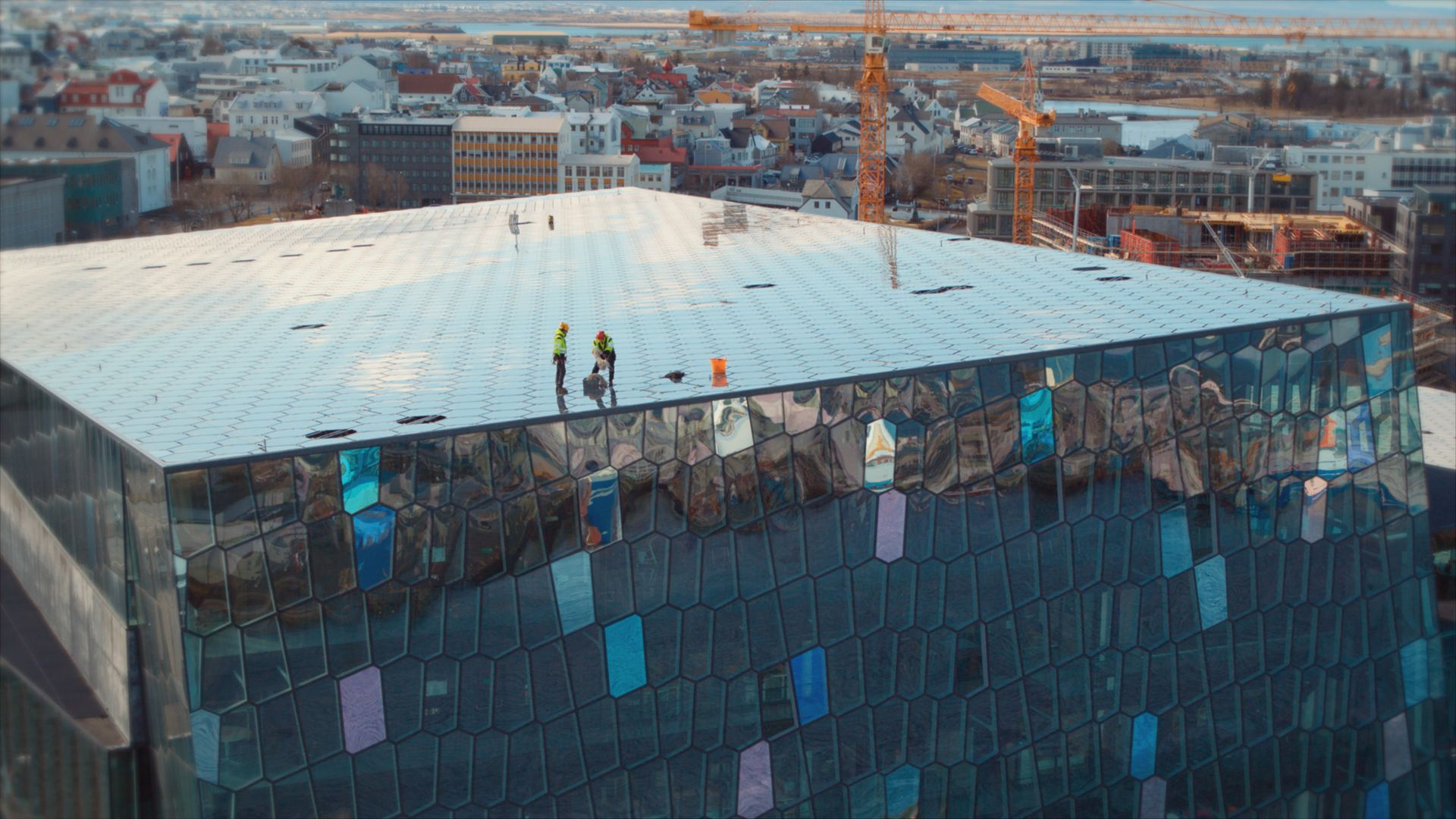 Window cleaners on top of the Harpa Concert Hall. This is from Europe from above, season 4. [Photo of the day - September 2021]
