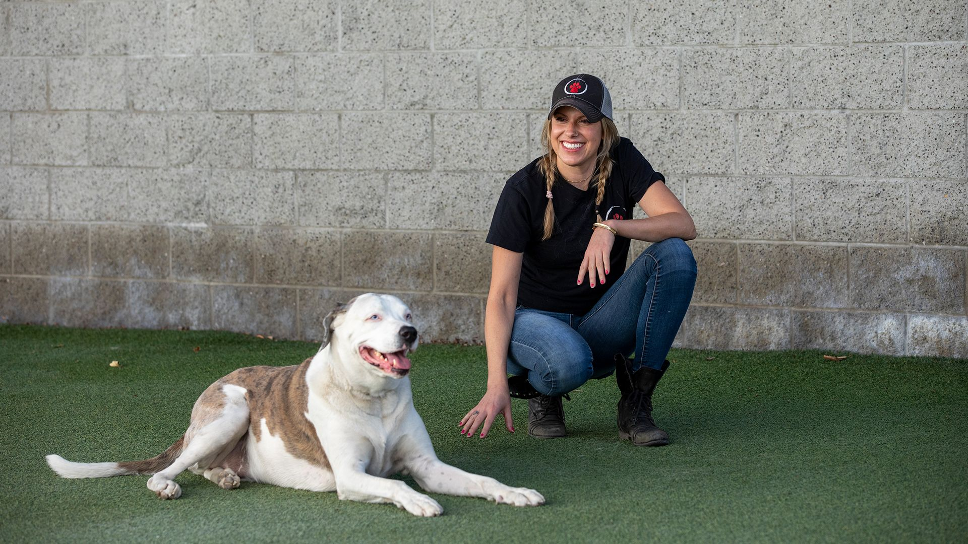 Stef DiOrio sits with Artie in the yard at The Zen Dog. This is from Dog Impossible [Photo of the day - October 2021]