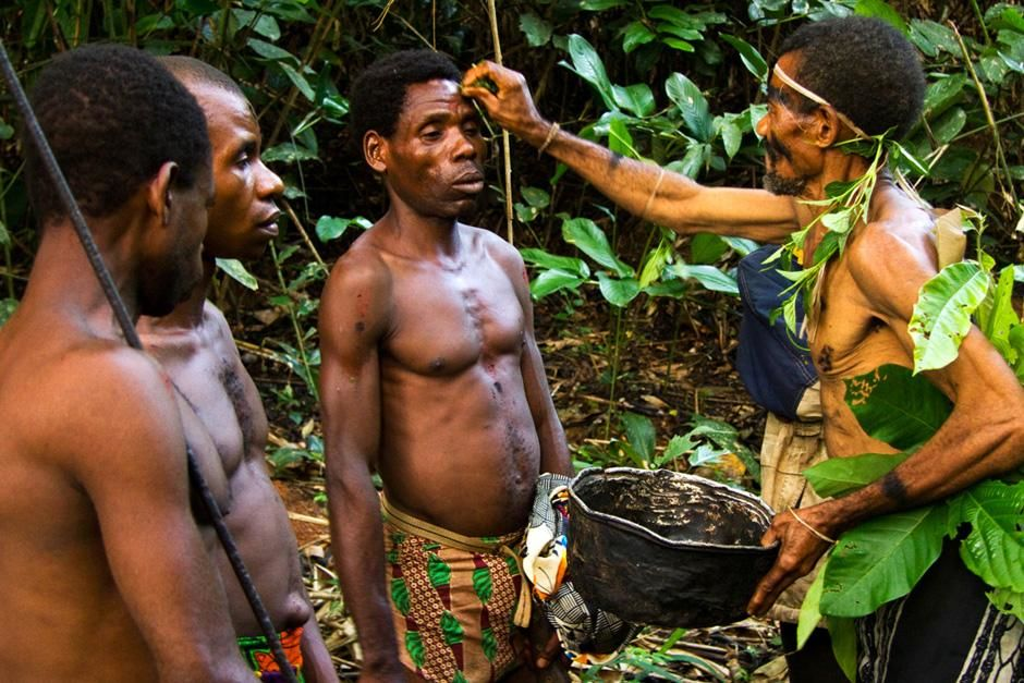 Cameroon, West Africa: Baka Pygmy hunters prepare for a hunt with a ceremony.  These Baka... [Photo of the day - August 2012]