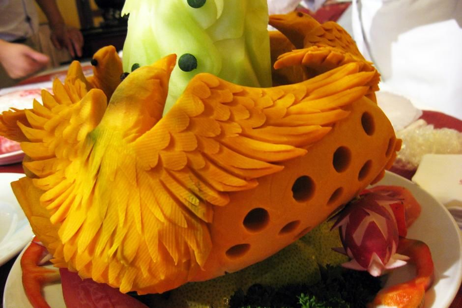 Birds carved out of yellow fruit. This image is from Food Lover's Guide to the Planet. [Photo of the day - September 2012]