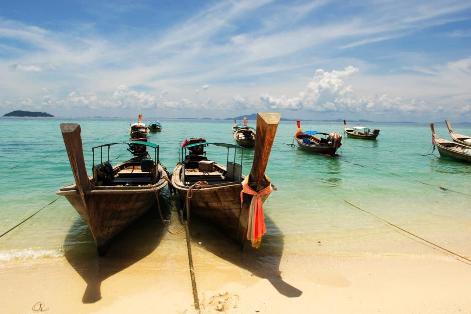 Boats tied along the shore.  Phi Phi Island, Thailand. This image is from Laya Project. [Photo of the day - October 2012]