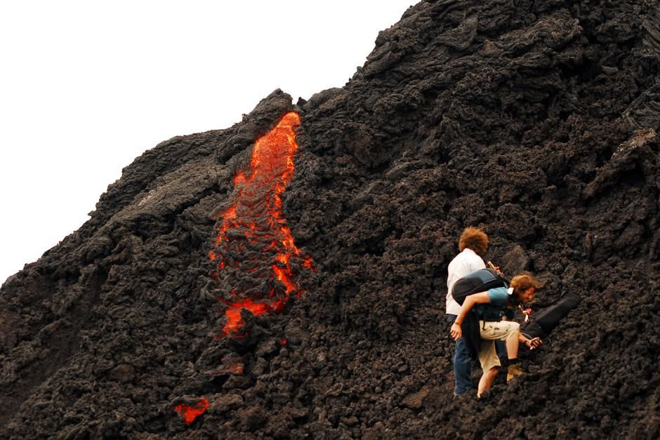 Pacaya Volcano, Guatemala: Two people come very close to lava on the Pacaya Volcano in... [Photo of the day - October 2012]