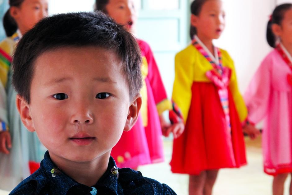 A young boy and his female classmates perform a song at their kindergarten class, located in the... [Photo of the day - 十一月 2012]