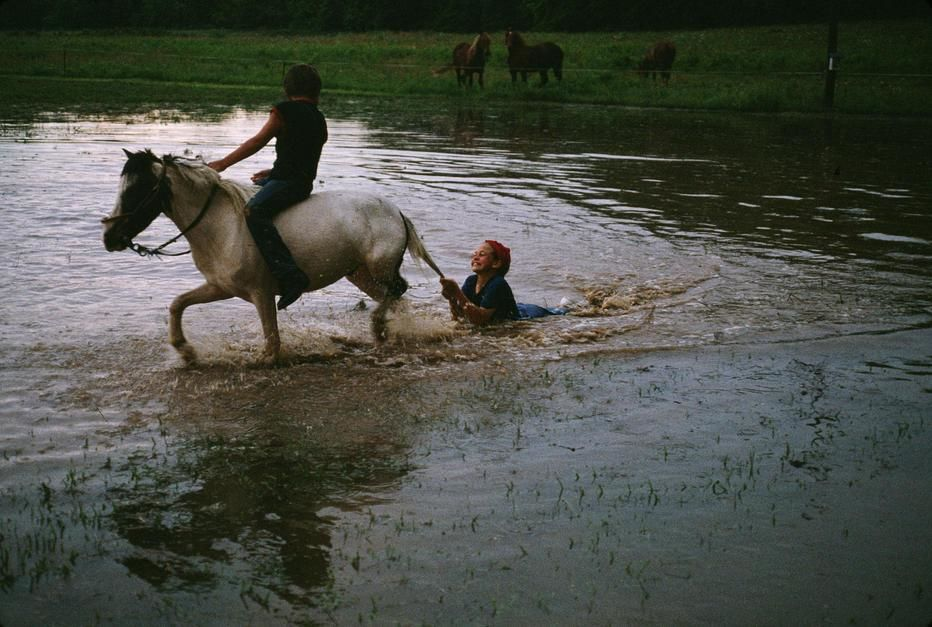 Mennonite farm children play at a water hole in Peace Valley, Missouri. USA. [Photo of the day - October 2011]