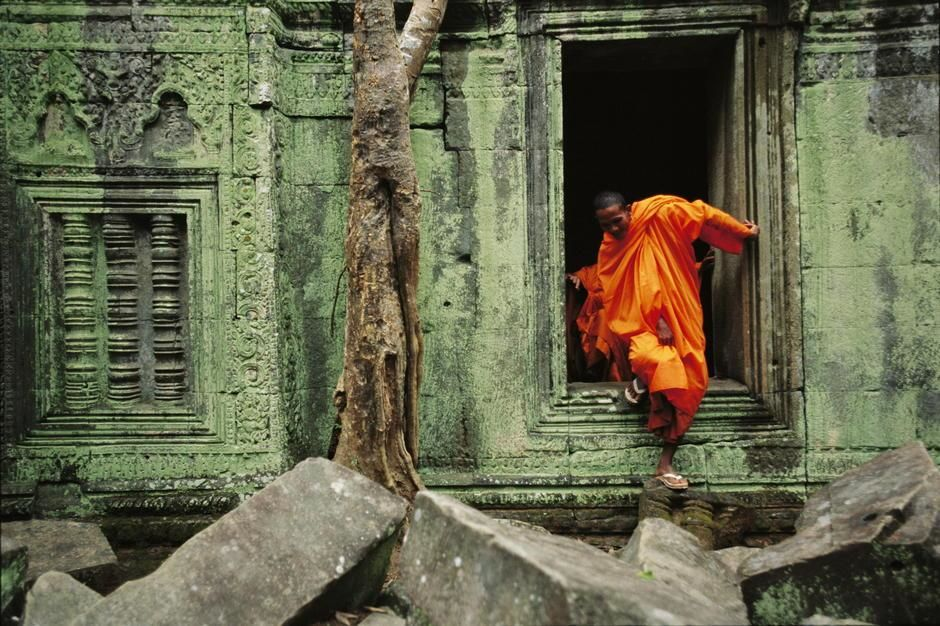 A monk emerges from the doorway of an Angkor Wat temple, Siem Reap. Cambodia. [Photo of the day - October 2011]
