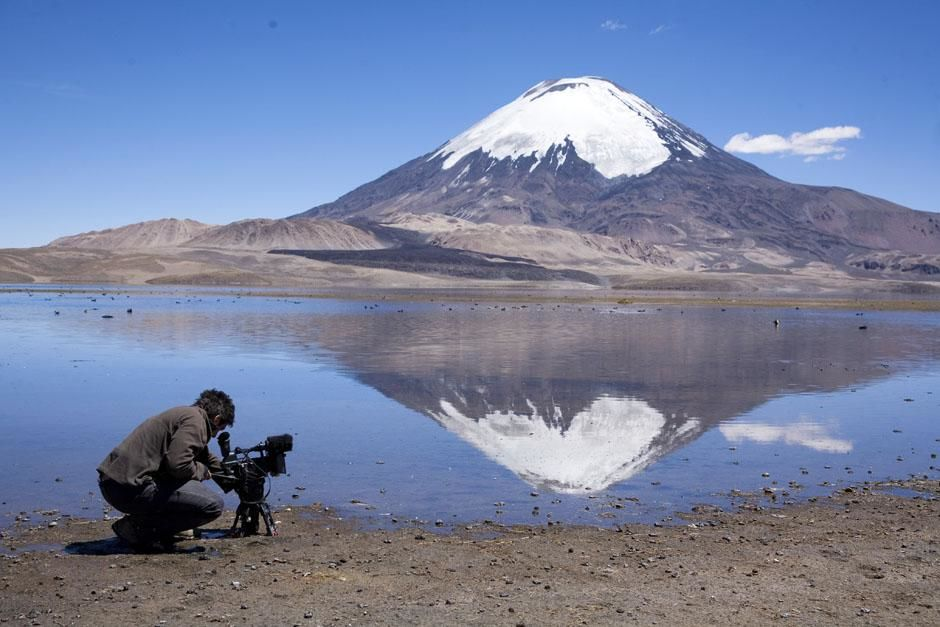 Salar de Surire, Chile: Andre Dupuis setting up for a shot. This image is from Departures. [Photo of the day - آوریل 2013]