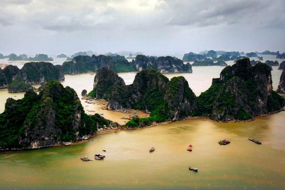 Ha Long Bay, Vietnam. Several boats floating about. This image is from Alien Deep. [Photo of the day - April 2013]