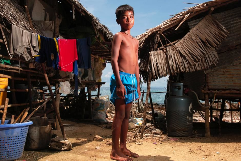 Phi Phi Island, Thailand: A young boy standing. This image is from Laya Project. [Photo of the day - April 2013]