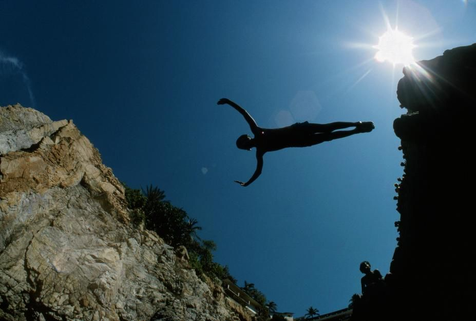 A cliff diver in flight, silhouetted against the blue sky in Acapulco. Mexico. [Photo of the day - November 2011]