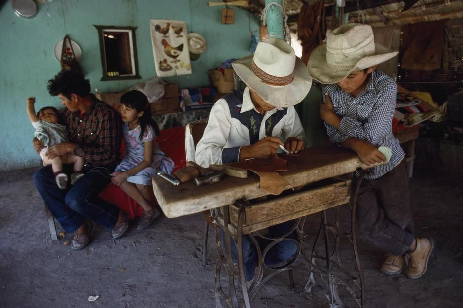 A farmer's children learn their father's trade as a saddlemaker, Baja California. Mexico. [Photo of the day - November 2011]