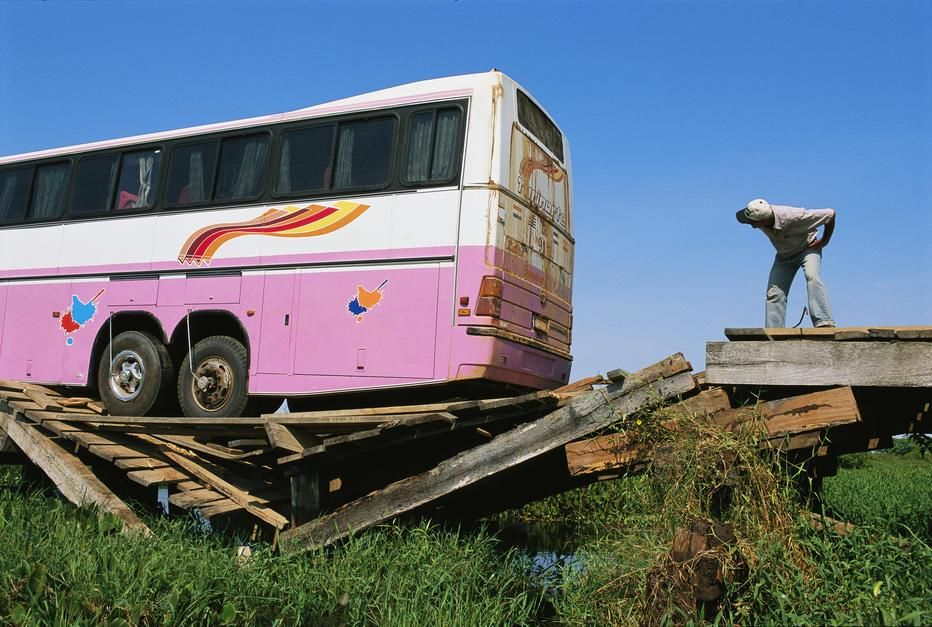 A tourist bus packed with people splinters a wooden bridge on the Transpantaneira Highway,... [Photo of the day - December 2011]