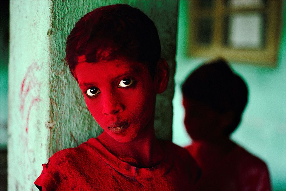 Mumbai, India: An Indian boy is dusted with red powder during Ganesh Chaturthi.  This image is... [Photo of the day - October 2013]