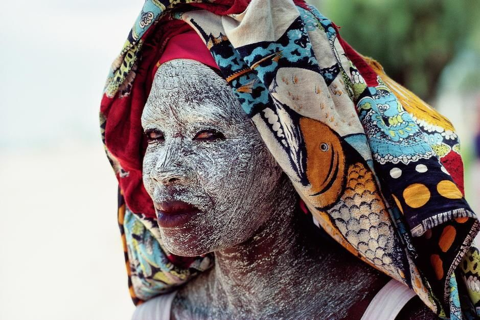 An African woman protects her face from the equitorial sun with cream made from ground bark in... [Photo of the day - December 2011]