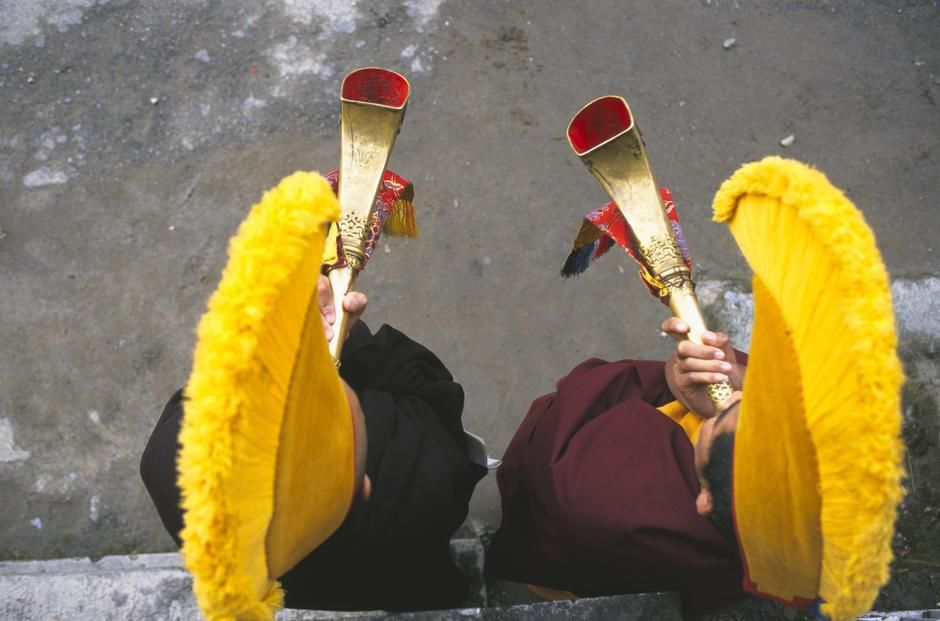 Monks in yellow hats blow horns at a fire puja at Nechung Monastery, Dharmsala. [Photo of the day - January 2012]