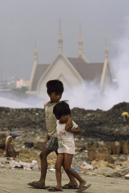 Children walk past Manila's Smoky Mountain on Luzon Island. [Photo of the day - January 2012]