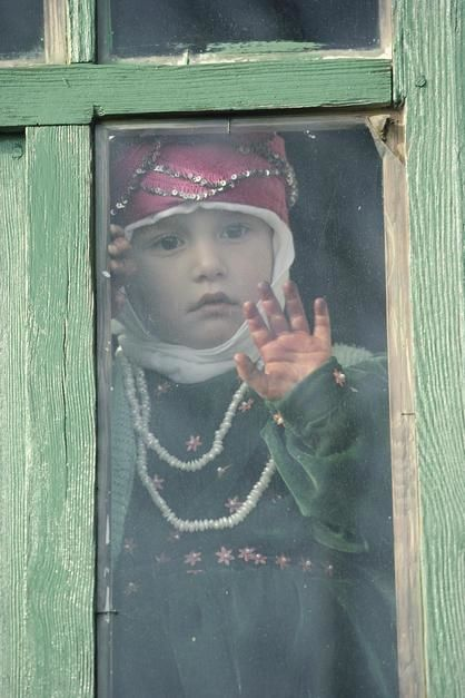 A young Turkish girl looks out of a window in Sogut Golu. [Photo of the day - January 2012]