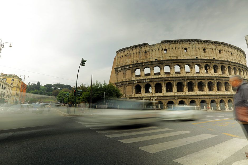 Rome, Lazio, Italy: Wide shot of the Colosseum in Rome, Italy with traffic speeding by. This... [Photo of the day - فوریه 2014]