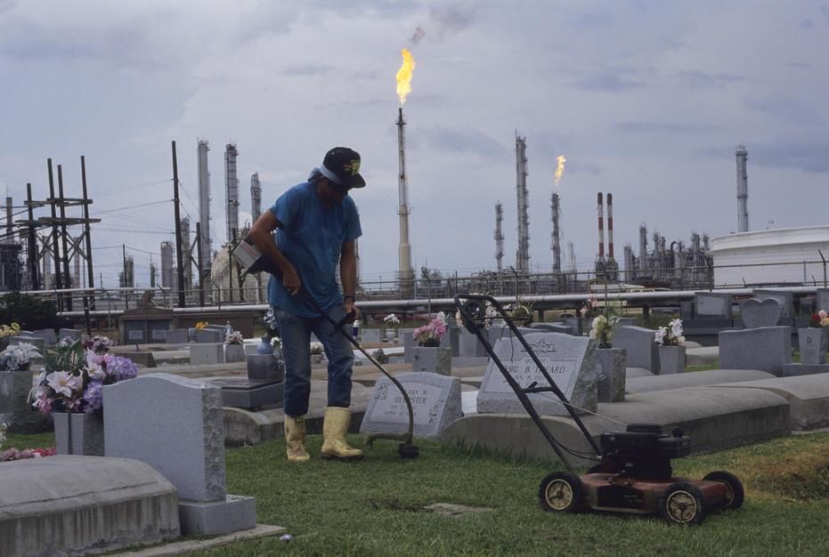 A man cuts the grass at a cemetary in an area known as Cancer Alley in Morrisonville, Louisiana. [Photo of the day - February 2011]