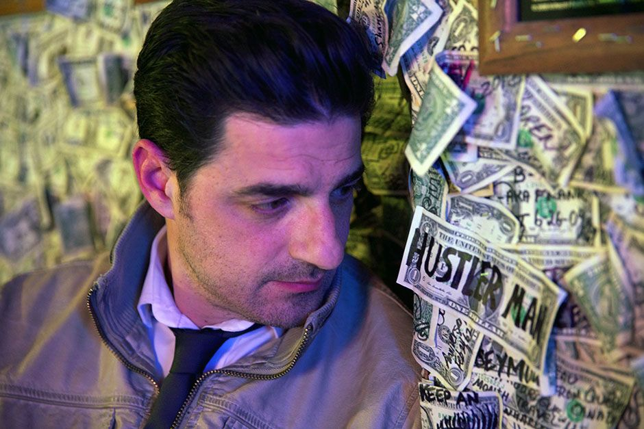 Oatman, Arizona, USA: Alexis Conran in the dollar bill bar where he made a bet involving... [Photo of the day - March 2014]