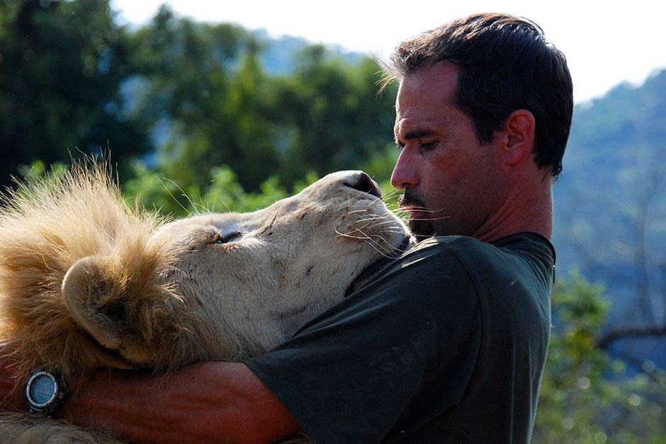 Kevin Richardson gets up close with a Lion. This image is from The Lion Whisperer. [Photo of the day - March 2014]