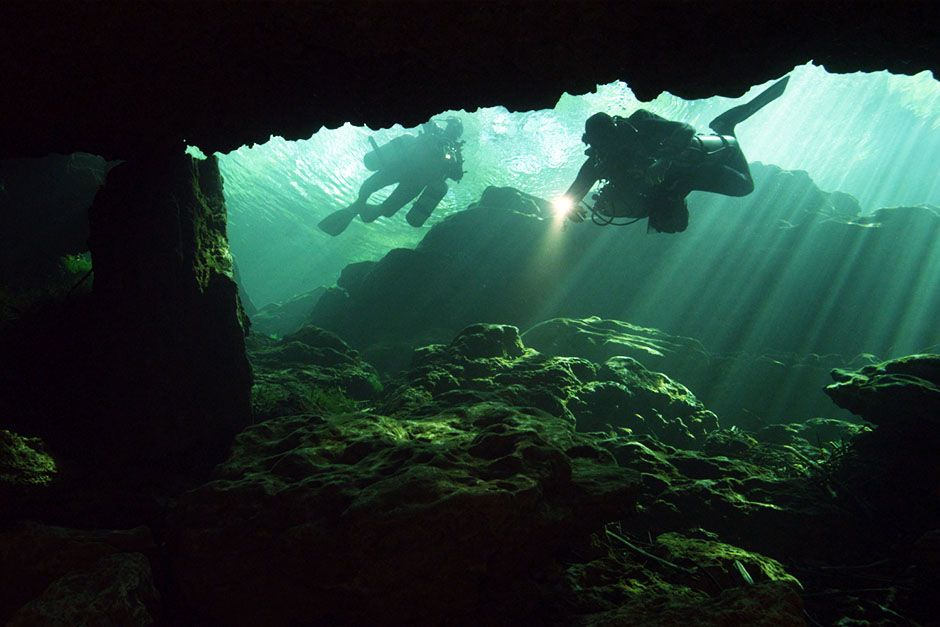 Bayonet Point, Florida, USA: Two divers exploring an underwater cave. This image is from... [Photo of the day - March 2014]