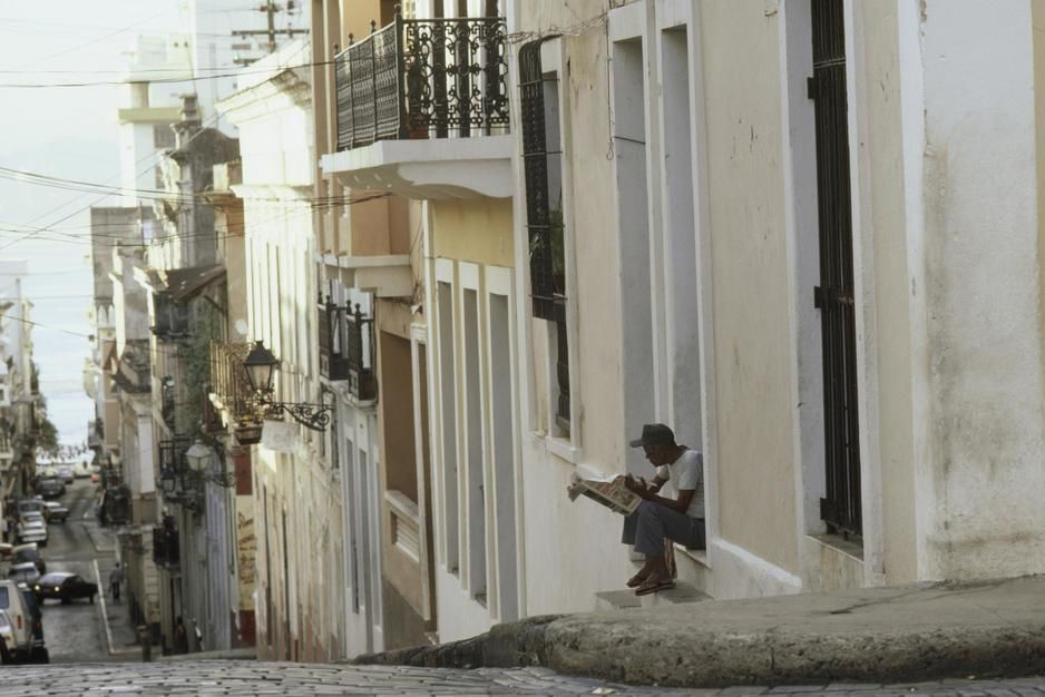A narrow street lined with restored buildings leads down to the bay in Old San Juan. [Photo of the day - March 2011]