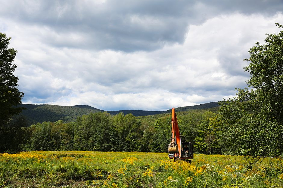 Arlington, VT, USA: The excavator in the field at Jeremy Pratico's property. This image is from... [Photo of the day - می 2014]