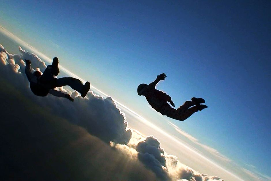 Skydivers jumping out of a plane. This image is from Do or Die. [Photo of the day - می 2014]
