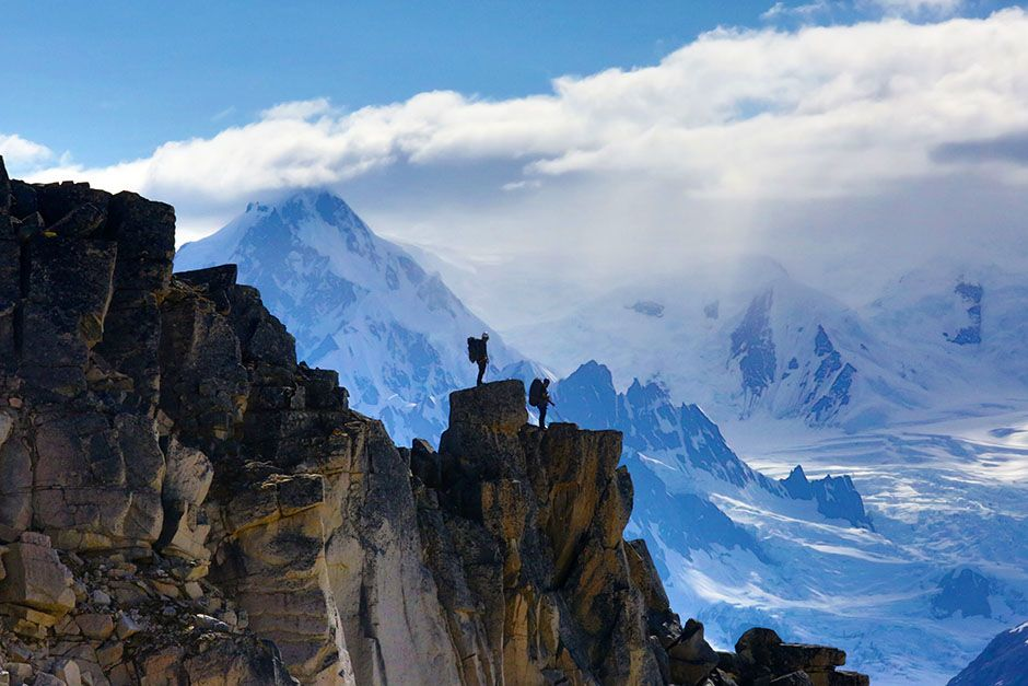 Tordrillo Range, Alaska, USA: A team waiting atop a mountain peak. This image is from Ultimate... [Photo of the day - August 2014]