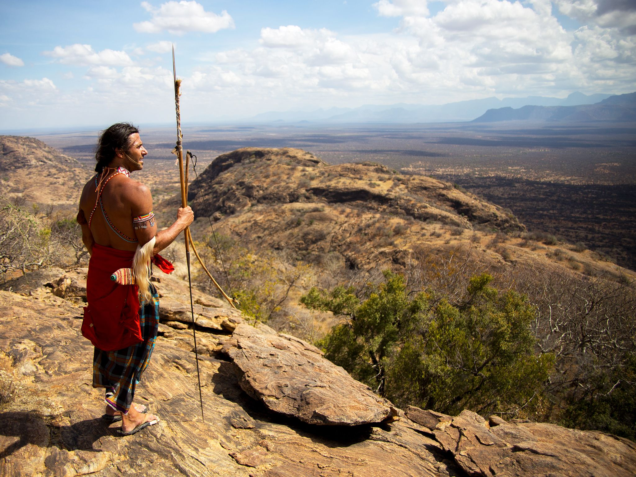 Mpagas, Kenya: Hazen Audel looking over the cliff edge. This image is from Survive The Tribe. [Photo of the day - September 2014]